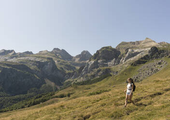 Woman hiking in mountains, Ordesa national park, Aragon, Spain - AHSF00848