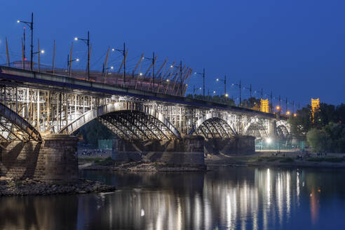 Poland, Masovian Voivodeship, Warsaw, Illuminated Poniatowski Bridge at night - ABOF00451