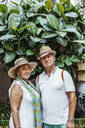 Portrait of senior couple with leaf background, El Roc de Sant Gaieta, Spain - MOSF00039