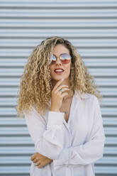 Portrait of young woman wearing sunglasses - DAMF00166