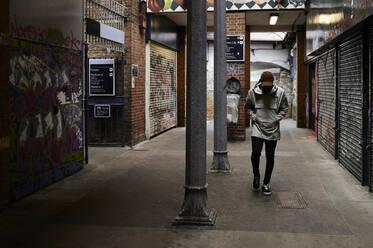 Man walking in an underpass, London, UK - IGGF01370