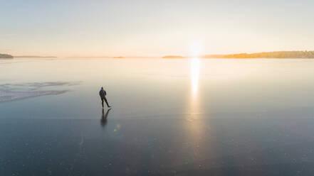 Ice skater on frozen sea - JOHF03035
