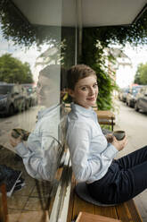 Portrait of a relaxed businesswoman at a cafe - KNSF06791