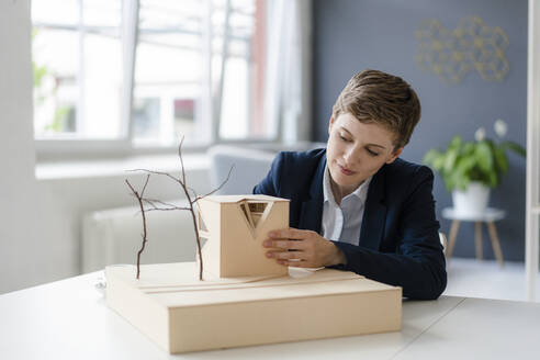 Businesswoman working on architectural model in office - KNSF06803