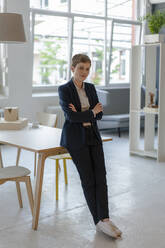 Portrait of confident businesswoman in office - KNSF06806