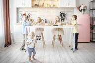 Fivechildren eating cookies in the  kitchen - EYAF00572