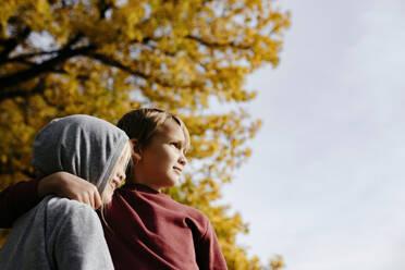 Two siblings enjoying autumn - EYAF00586