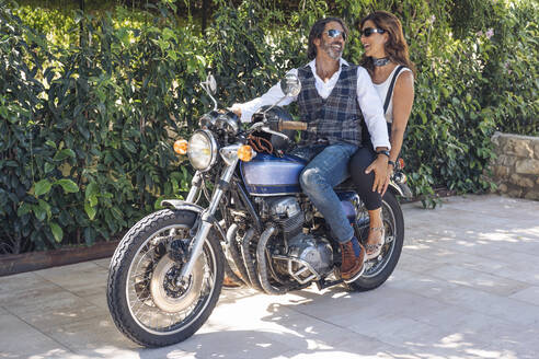 Happy mature couple on a vintage motorbike - DLTSF00252