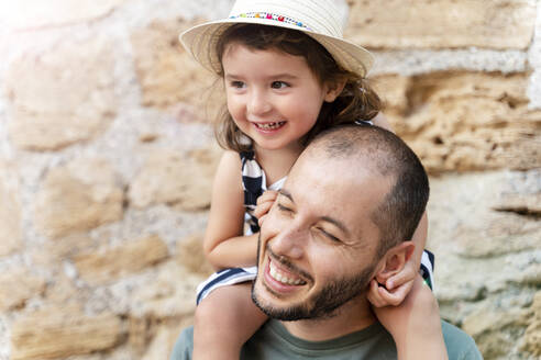 Portrait of happy little girl on her father's shoulders - GEMF03219