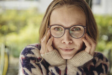 Portrait of young woman with glasses wearing fluffy sweater - MFF04880
