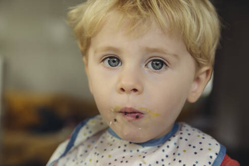 Portrait of blond little boy eating caviar and egg - MFF04889