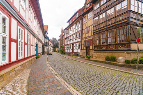 Historic timbered houses with old car in Hildesheim city center - CAVF65519