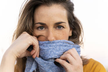 Young woman wearing blue scarf, looking at camera - AFVF04069