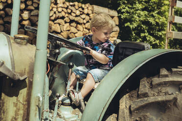 Little boy pretending to drive a tractor - MFF04905