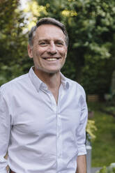 Portrait of a mature smiling man in the garden - MFF04932