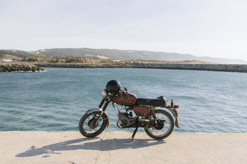 View of old motorcycle on the sea shore, Nazare, Portugal - AHSF00930