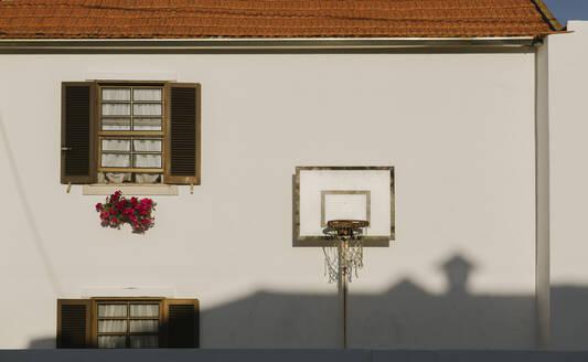 View of basketball hoop outside of the house, Costa Nova, Portugal - AHSF00948