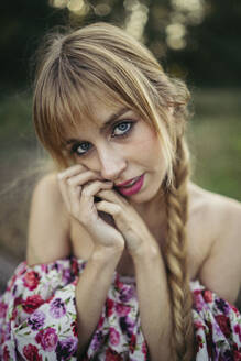 Portrait of young blond woman with braid in summer - MTBF00026