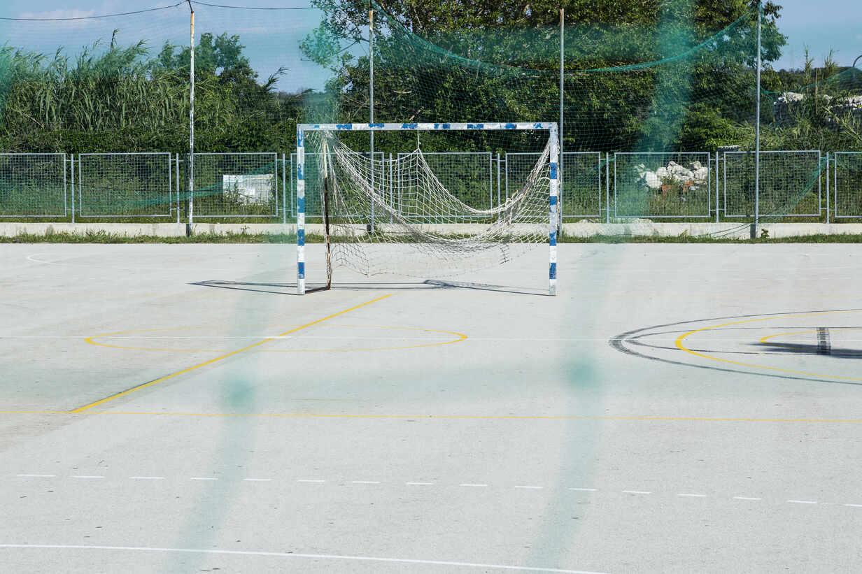 Croatia, Nin, Soccer goal standing in empty schoolyard - NGF00526 - Nadine Ginzel/Westend61