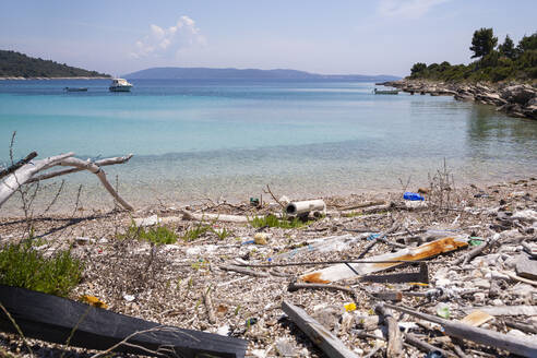 Croatia, Split, Coastal beach covered in trash - NGF00535