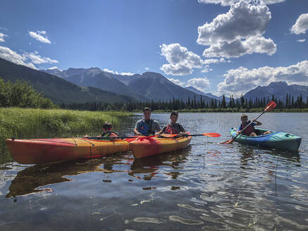 Father and sons kayaking on Vermilion Lakes in Banff National Park. - CAVF65681