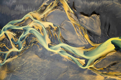 Aerial view of a volcanic river just outside of Villingholt, Iceland. Rivers like this are all over the Icelandic landscape, with colors ranging from yellow to blue to green. - AAEF04538