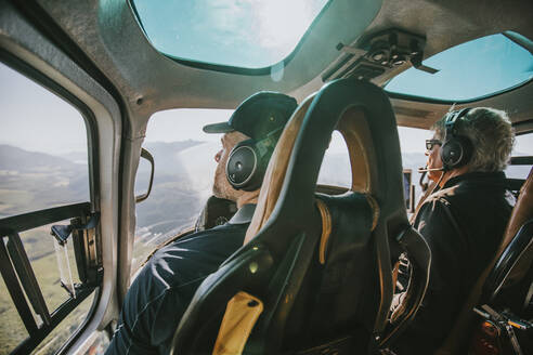Pilot and passenger in a Search and Rescue Helicopter - CAVF65747