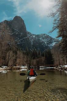 Man kayaking in lake, Yosemite Village, California, United States - ISF22624
