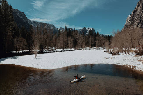 Man kayaking in lake, Yosemite Village, California, United States - ISF22627