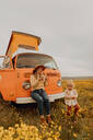 Mother with daughter on road trip in countryside - ISF22642
