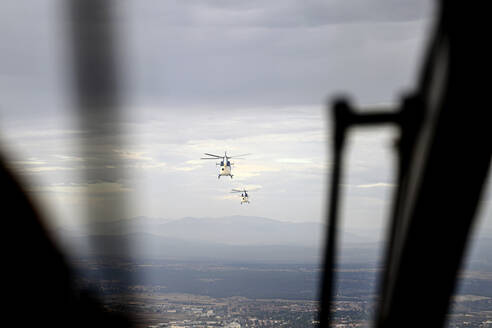Police helicopters seen from inside the cabin of an aircraft. From Madrid, Spain - OCMF00830