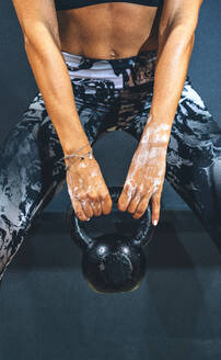 Woman in good shape exercising with a kettlebell - JCMF00274