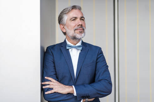Portrait of elegant mature businessman outdoors - DIGF08517
