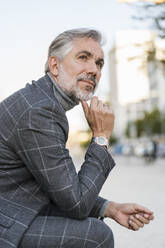 Portrait of fashionable mature businessman in the city - DIGF08625