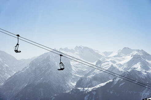 Snow covered mountain landscape with ski lift,  Alpe-d'Huez, Rhone-Alpes, France - CUF52645
