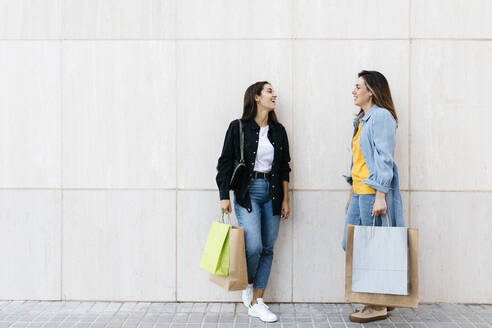 Two friends talking during shopping - JRFF03792