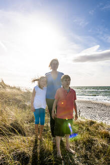 Mother with two children in a beach dune at the sea, Darss, Mecklenburg-Western Pomerania, Germany - EGBF00492