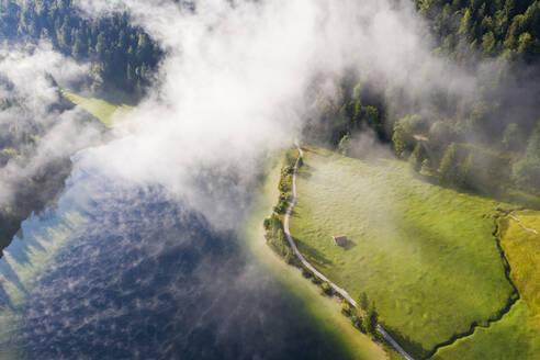 Germany, Bavaria, Mittenwald, Aerial view of fog floating over Ferchensee lake - SIEF09235
