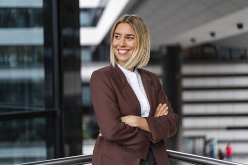 Portrait of confident young businesswoman in the city - DIGF08679