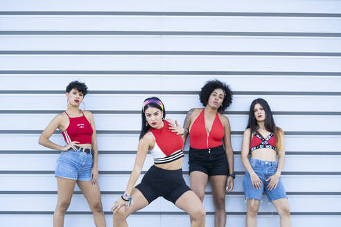 Four young sexy dancing on a strett in front of a wall - DAMF00206