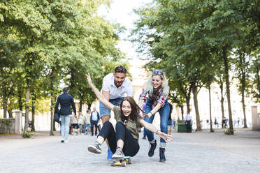 Group of three friends having fun with skateboard - WPEF02217