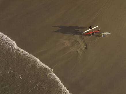 Aerial view of surfers at the beach - CAVF66861