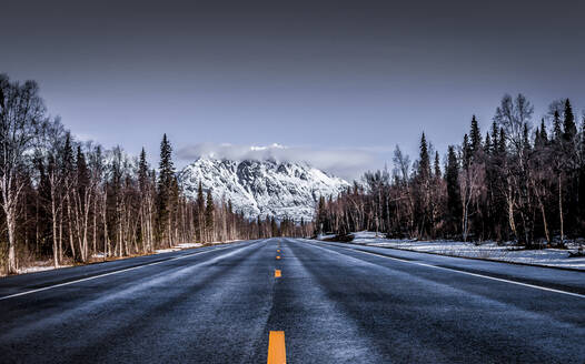 Empty country road against sky during winter - CAVF67850