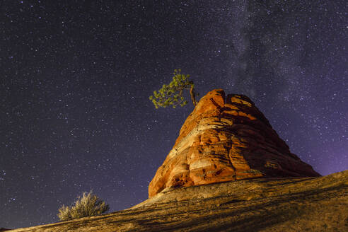 Low angle majestic view of rock formation against star field at Zion National Park - CAVF67877
