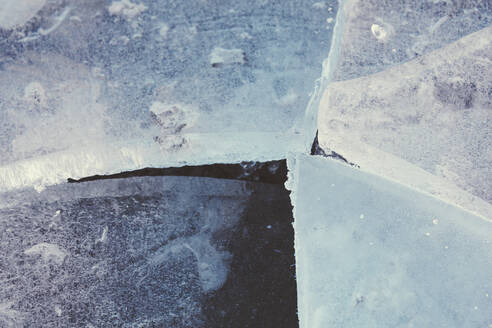 Germany, North Rhine-Westphalia, Wuppertal, Close-up of cracked ice in winter - DWIF01060