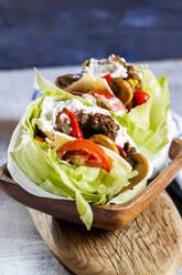 Low carb burgers with bun salad, roasted vegetables and tzatziki sauce  - SBDF04075