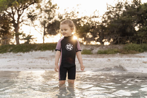 Cute toddler girl standing in the sea - DIGF08727