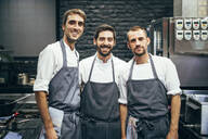 Portrait of three cooks in the kitchen of a restaurant - OCMF00867