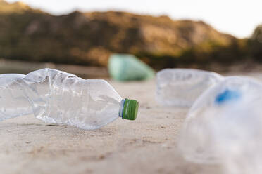 Empty plastic bottles on the beach - DIGF08855