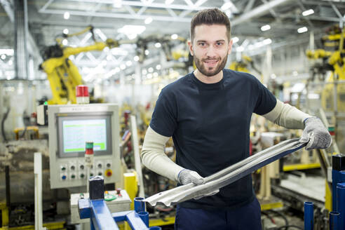 Portrait of confident man working in a modern factory - WESTF24300